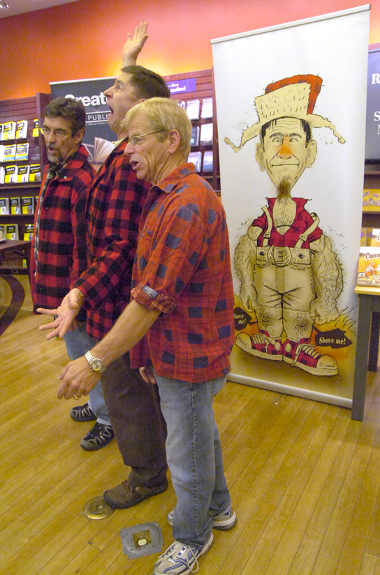 Buddy Wasisname and the Other Fellers perform for people gathered for the release of the book Chainsaw Earle at Chapters Saturday afternoon. The book is based on a song by Buddy Wasisname and the Other Fellers and illustrated by Kevin Tobin, The Telegram's editorial cartoonist.— Photo by The Telegram